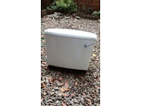 White cistern with dual flush mechanism
