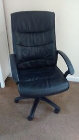 Black leather look swivel chair