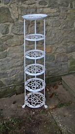 Cast iron six tier storage rack for pans or for display purposes. Used and refurbished