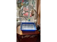 For sale, a large Parrot cage with accessories.