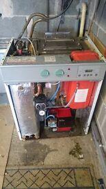 Worcester Bosch Heatslave 26/32 Oil Combi Boiler.
