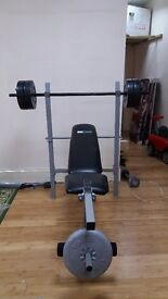 Exercise bench with weights,rods and dumbells