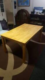 Solid wood light light oak dining table 150 x 90cms
