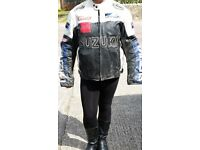 mens large suzkui racing bike jacket in black with white arms used condition