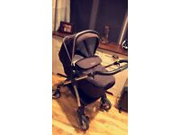 Silver cross wayfarer pram in Black, includes carrycot and stroller seat.