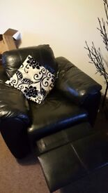 Black leather reclining arm chair