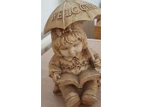Little girl with umbrella. Garden Ornament