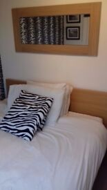 Double bed with new mattress for sale