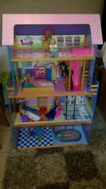 Big wooden dolls house with lift plus dolls and furniture