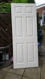 Internal white painted panel wooden door