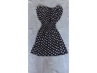 Navy and white polka dot dress with expanded waist