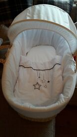 clare de lune moses basket with white accessories.