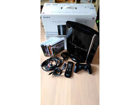 80GB Sony Playstation 3 (PS3) Console with Wireless Controller, 4 Games & Media Remote.