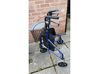 Blue Three-wheeled Mobility Walker with detachable basket and tray.