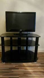 """Tv 24"""" Goodmans and TV stand"""