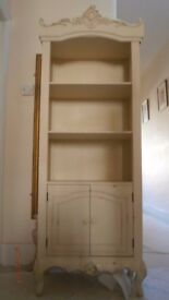 small children shelving bookcase with 2 small doors