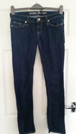 Genuine pair of designer Guess jeans size 8