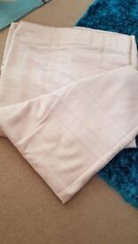 2 pairs of beige curtains