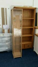 £55 - 1 door glass display cabinet - new and unused - delivery available