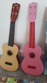 2 toy guitars