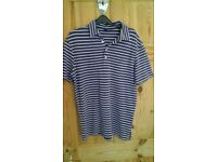 size medium purple and white striped ralph polo shirt with green logo