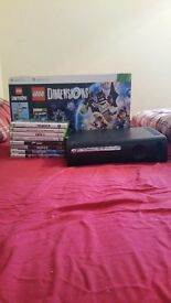 Xbox 360 with various games and lego dimeson set