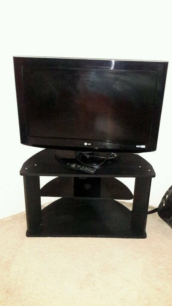 LG TV WITH REMOTE AND STAND