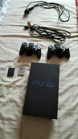 Ps2 console and 2 controllers and a loads of games