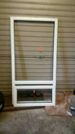 A PVC WINDOW IN GOOD CONDITION