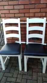 Two White dinning room chairs