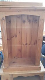 Pine table. Few cat claw marks on leg.but can be rubbed down.annd pine bookcase.