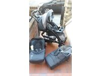 Mothercare pushchair / comes complete with car seat, carrycot and rain cover