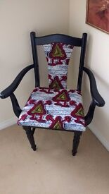 Black chair with Africa wax print upholstry