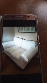Two seater sofa, in very good condition, removable covers for convenient washing in cream