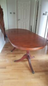 Yew oval extending dining table seats eight.