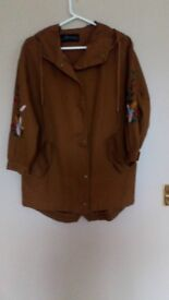 Ladies casual jacket with hood never been worn with embodiary on sleeves