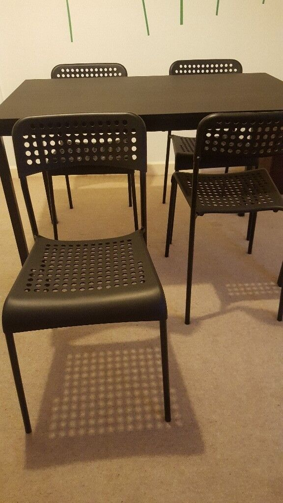 £50. New IKEA black dining table + 4 chairs.