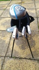 Used Dunlop MXII Junior Golf Clubs and Bag. 5, 7, 9 irons, Driver and Putter.