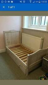 Toddlers bed with a pull out drawer