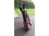 Golf clubs with bag for sale.