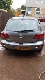 Grey Mazda 3 2004.