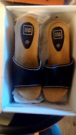 Pair black mules brand new in box sze 7E, simply be