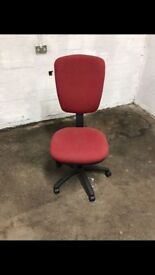 Red spinning office chair