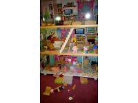 Large dolls house(around 4.5ft) and full bag of people and furniture