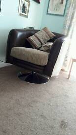Beautiful leather and beige fabric swivel chair