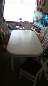 Whitewash extending dining room table and 6 red upholstered chairs £95 ONO. NOW £70. NO OFFERS