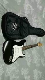 Black and white sx stratocaster with case