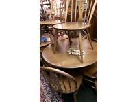 Ercol Dinning table and 6 chairs 1metre diameter round table good condition 380 pounds ono