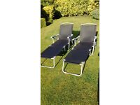 Pair of folding sunloungers