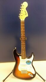 Electric Guitar Squier Stratocaster Affinity Series by Fender, an amplifier, a bag, a stand, etc.